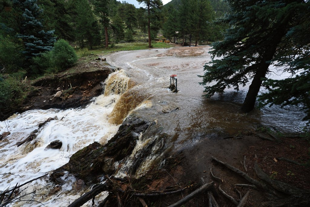 A Thousand-Year Rain: The Historic Flood of 2013 in Boulder and Larimer Counties: Prairie Mountain Publishing: 9781597254854: Amazon.com: Books