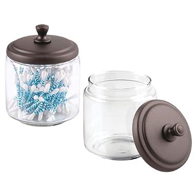 mDesign Glass Bathroom Vanity Storage Organizer Canisters Jars for Cotton Balls, Swabs, Beauty Blenders, Makeup Sponges, Bath Salts, Hair Ties, Jewelry - Pack of 2, Clear Jar/Bronze Lid