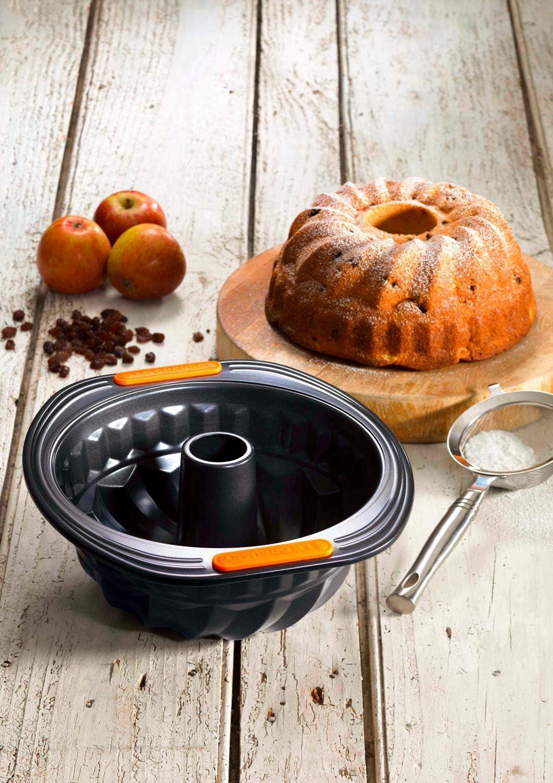 Le Creuset Molde bundt redondo, diametro 22 cm, Libre de PFOA, Resistente a ácidos, Revestimiento de acero al carbono, Gris y Naranja