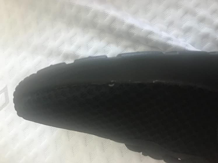 NIKE Women's Tanjun Running Shoes Not only are they FAKE Nike's they are a poor imitation. You can see the blue sound the ...