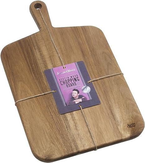Peeling chestnuts on an acacia chopping board