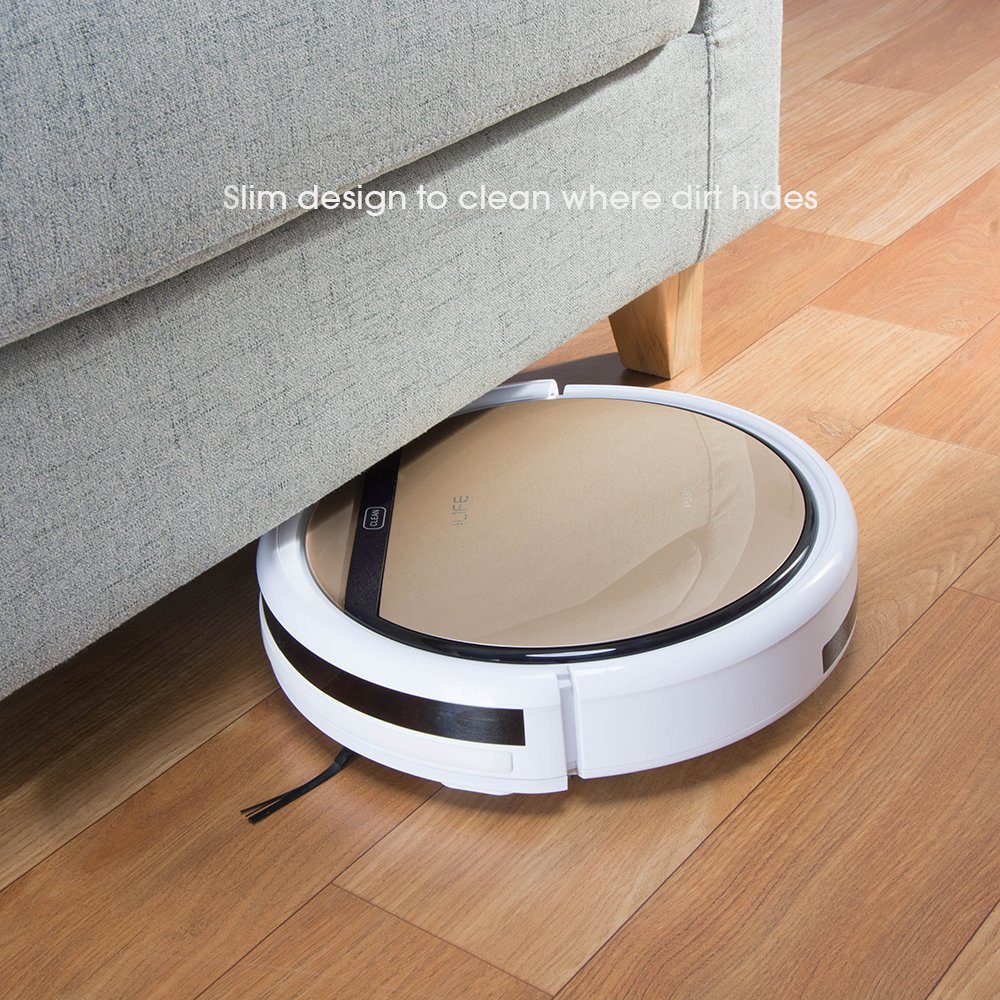 The best robot mops can easily glide under and around furniture. The ILIFE V5s model shown sliding under a piece of furniture.