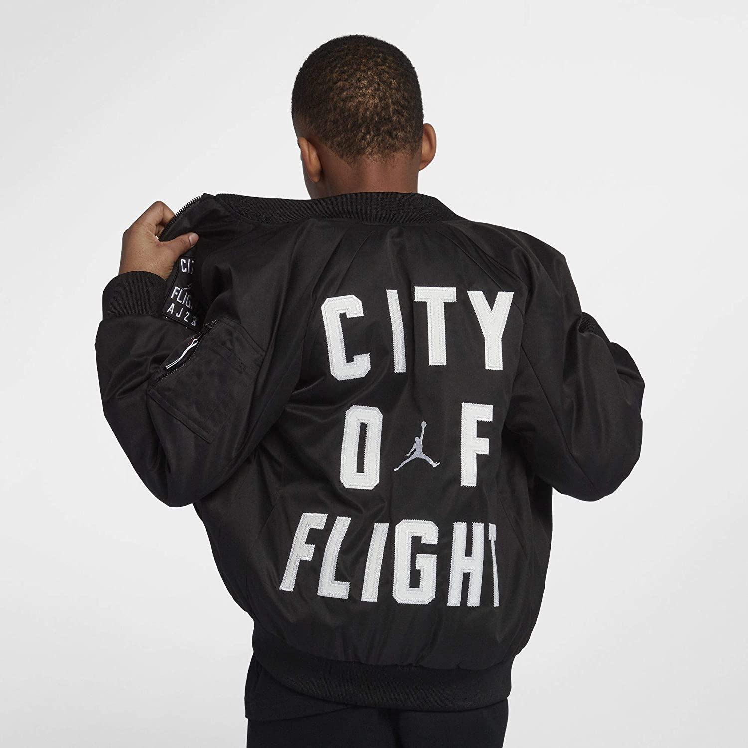 aa2e2f80804914 Amazon.com  Nike Jordan City of Flight MA-1 Big Kids  (Boys ) Jacket   Clothing