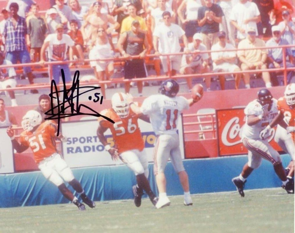 Jonathan Vilma Signed Picture - UM 8x10 W COA - Autographed College Photos  at Amazon s Sports Collectibles Store 3f999e2ec