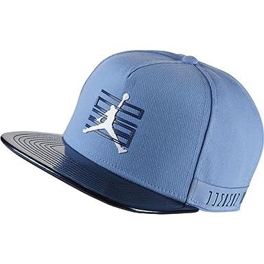 f843a309f9a4 Nike Mens Jordan 11 Snapback 874970-412 - University Blue Midnight Navy White   Amazon.co.uk  Clothing