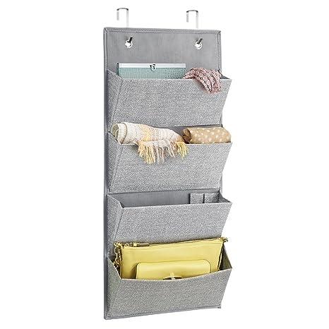 mDesign - Organizador de tela, para guardarropa, de pared o para colgar sobre perfil de puerta; para bolsas de mano, accesorios para el cabello, 4 bolsillos - Gris
