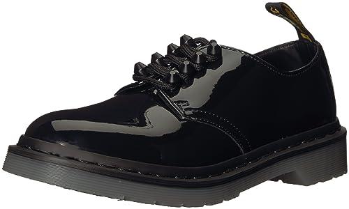 Stringata Dr. Martens 4 fori in pelle verniciata nera con borchie   Amazon.it  Scarpe e borse b2a067f680d