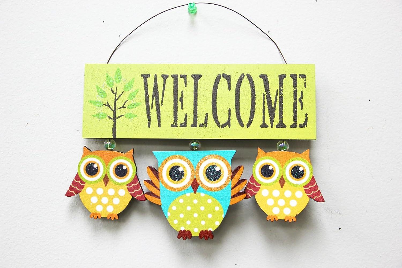 Vintage designed wood owls welcome sign