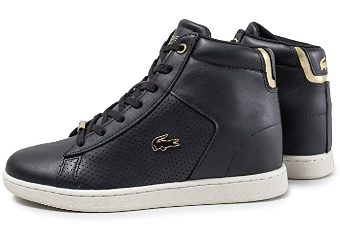 5b572bb40 Lacoste Womens Carnaby Evo Mid Wedge Trainers Sneakers in Black Gold.   Lacoste  Amazon.com.au  Fashion