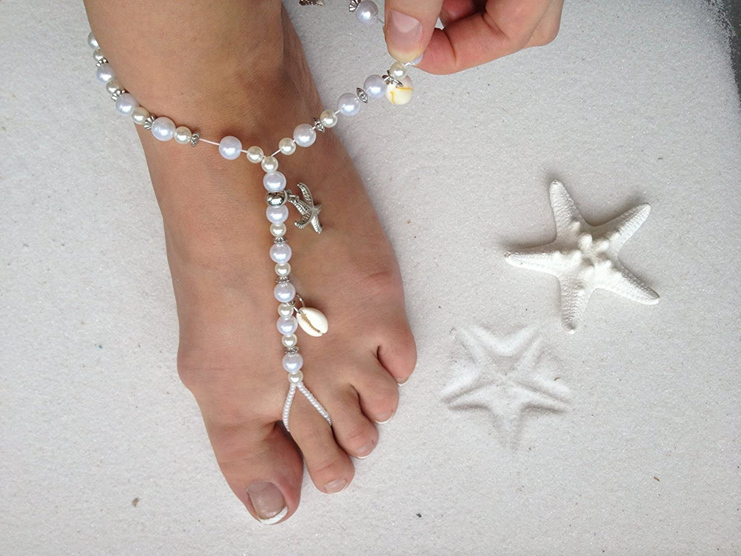 5c9f3fb5ed24a Amazon.com  Ivory Barefoot Sandals Beach Wedding Beaded Anklet with  Starfish and Real Seashells - Set of 2  Shoes