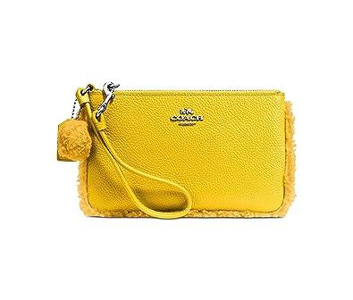 91d4d5ded3 Coach Shearling Small Leather Wristlet Faux Fur Pom Pom Trim Banana Yellow  New: Handbags: Amazon.com