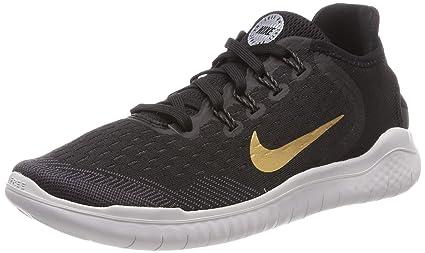 704d9156550d7 Nike Women s Free RN 2018 Black Metallic Gold Vast Grey Running Shoe 7.5  Women