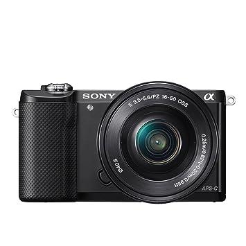 Sony A5000 con objetivo 16-50mm y libro de fotografía digital ...