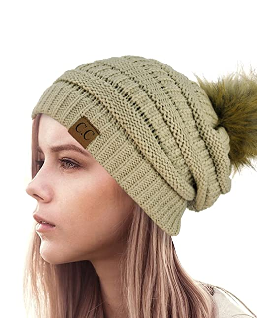 60bedb5ef222a NYFASHION101 Exclusive Soft Stretch Cable Knit Faux Fur Pom Pom Beanie Hat  - Beige at Amazon Women s Clothing store