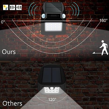 Lámpara de LED, solar, de seguridad, con sensor de movimiento y detección de 180 grados, impermeable, para patio, entrada, camino (12 LEDs RGBW), ...