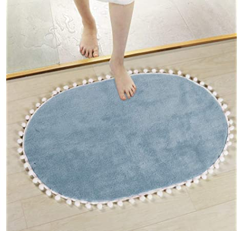 LEEVAN Faux Wool Bath Rug Shaggy Absorbent Soft Cozy Bathroom Door Mat Cute Pom Pom Fringe Non-Slip Oval Small Floor Carpet Decorative Machine Washable 18x25Light Blue