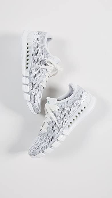 promo code e31de 8c28b Amazon.com   adidas by Stella McCartney Women s Kea Clima Sneakers,  White Green Collegiate Navy, 7 M UK   Fashion Sneakers
