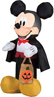 gemmy airblown inflatable mickey dressed as a vampire with a cape and holding tote halloween decoration