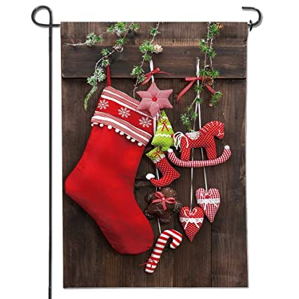 garden flag christmas decoration stocking and handmade toys over rustic wooden background house flag decoration double