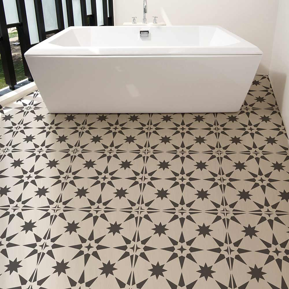 Jewel Tile stencil by Cutting Edge Stencils on a floor in a bathroom. #stencil #cementtile #fauxtile