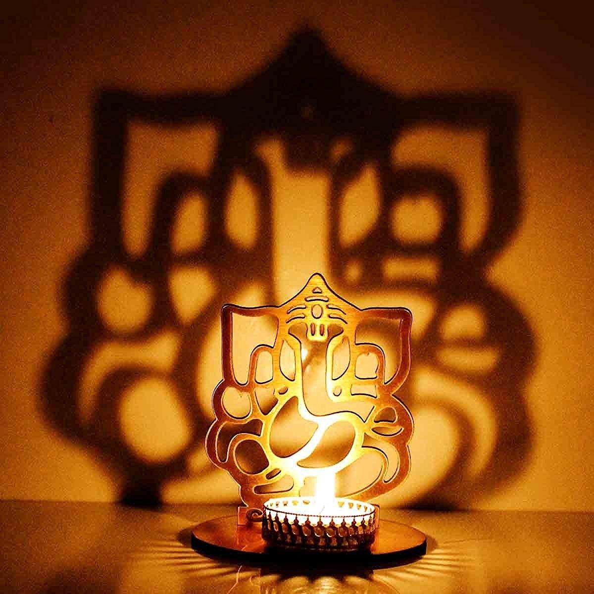 Buy Indigo Creatives Lord Ganesha Shadow Tea Light Puja Decoration ... for Lighting Lamps In Pooja Room  183qdu