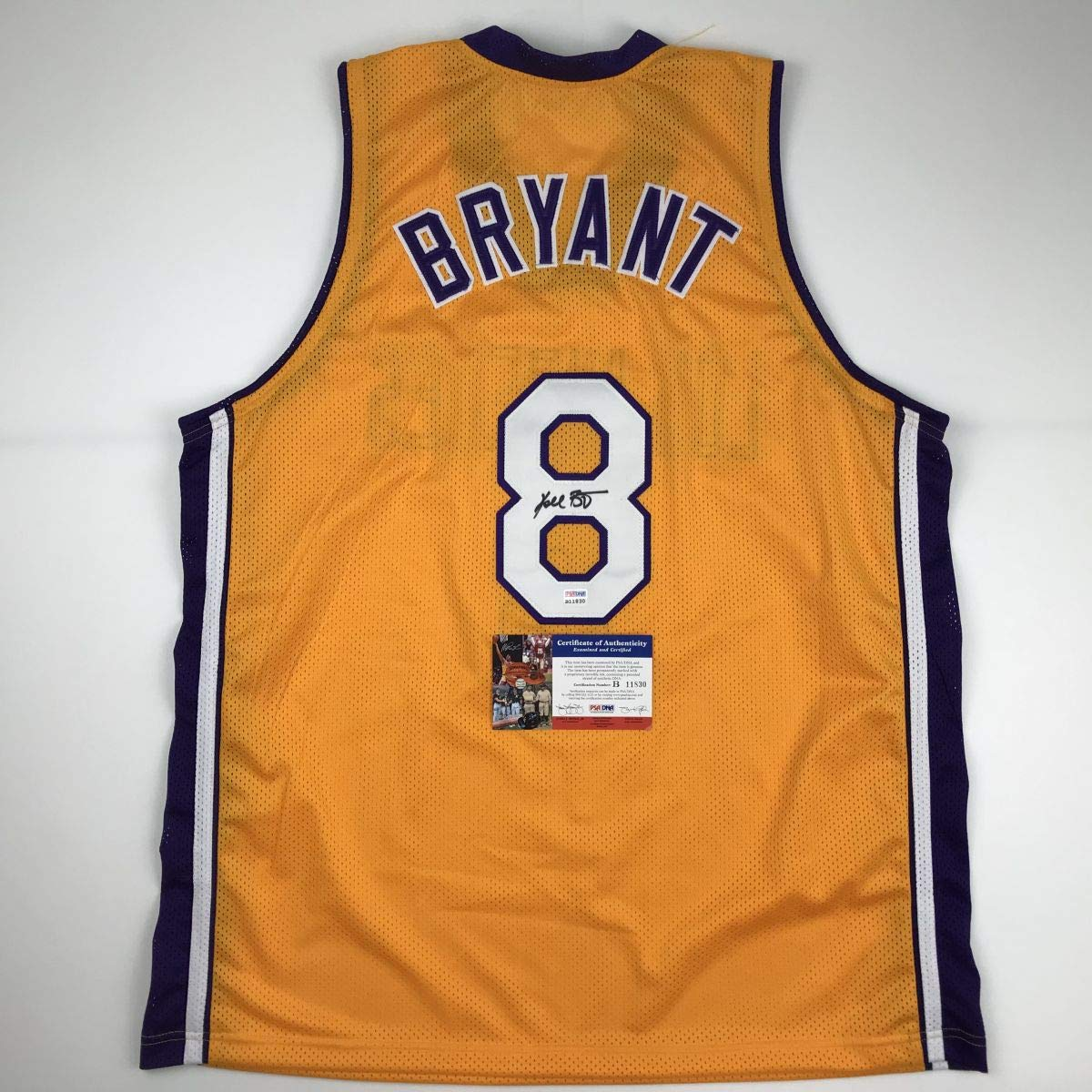 e58cc655656 Autographed/Signed Kobe Bryant #8 Los Angeles Yellow Basketball Jersey  PSA/DNA COA at Amazon's Sports Collectibles Store