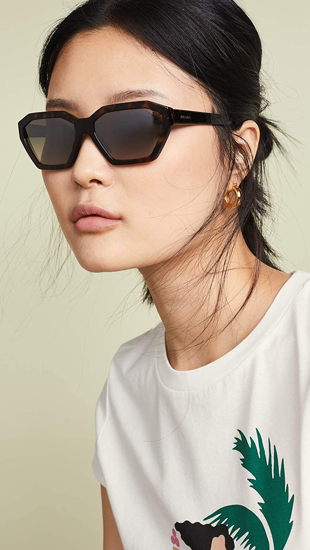 77daf36cc014 Amazon.com: Prada Women's 0PR 03VS Black/Gradient Light Brown/Mirror Gold  One Size: Clothing