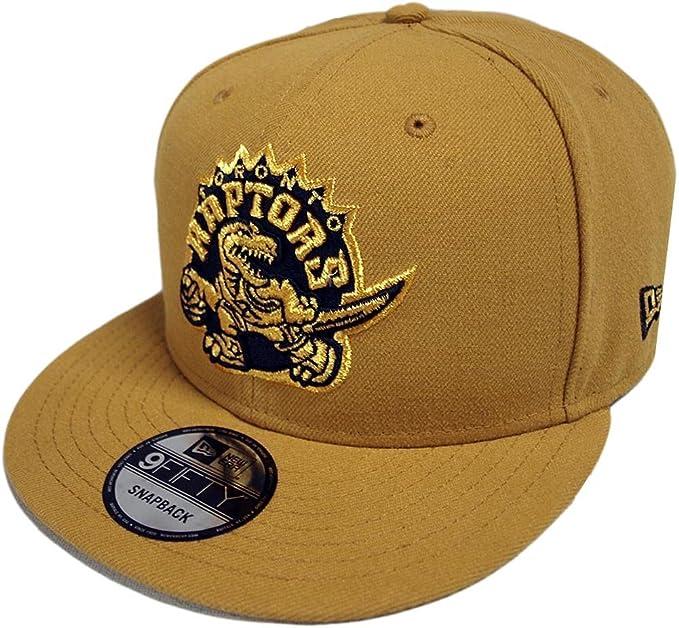 hot sale online 06100 c0c6b New Era Toronto Raptors HWC Tan Gold Snapback Cap 9fifty 950 Limited Edition   Amazon.co.uk  Clothing