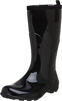 Shiny black festival rain boots on white background