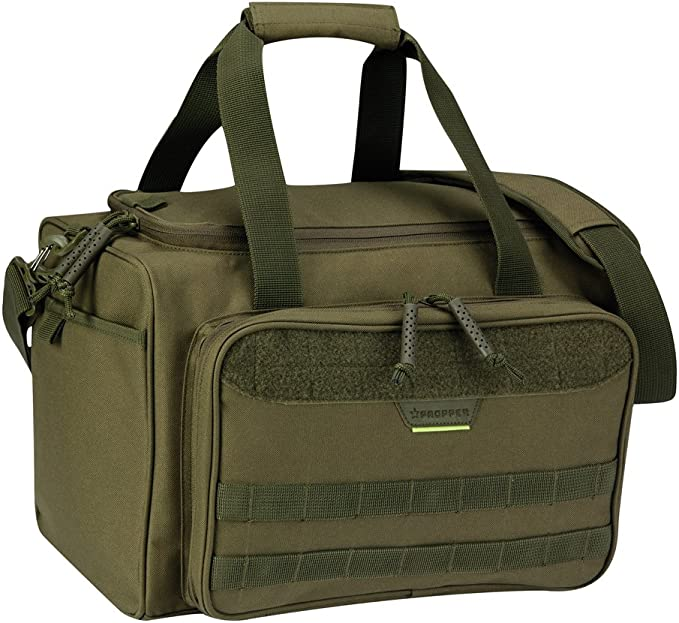 Image of a tactical range bag in olive green shade, with front pocket, hand straps extended upwards.