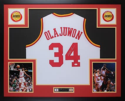 8d52ac076 Hakeem Olajuwon Autographed White Jersey - Beautifully Matted and Framed -  Hand Signed By Hakeem Olajuwon