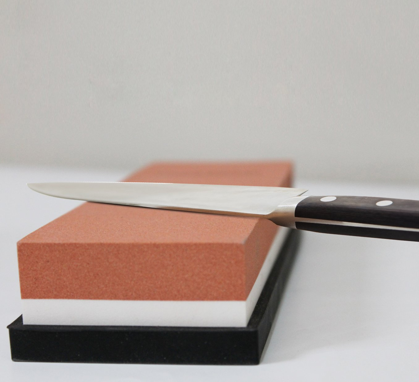 Sharpening a knife with a sharpening stone