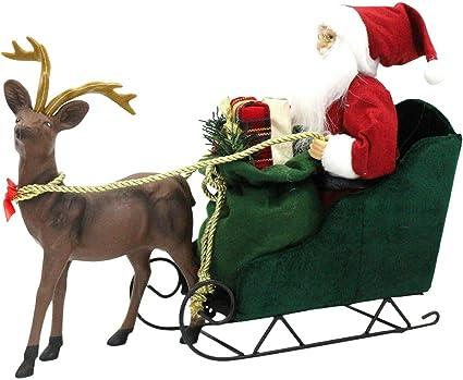 Regali Di Babbo Natale.Grande Babbo Natale Sulla Slitta Con Renna Carro Di Natale Che Tiene Regali Di Natale Amazon It Casa E Cucina