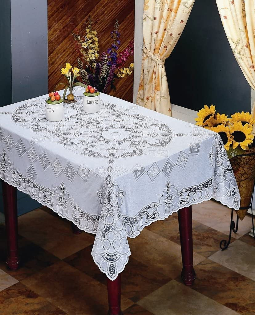 A very simple lace tablecloth in optic white of rectangle  shape by fiz fabrics
