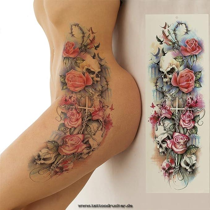 Tatuaje de brazo XXL con rosas, espinas, pájaros, calaveras, cruz ...