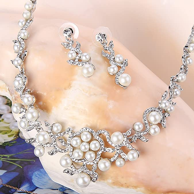 Ever Faith Cristal Autrichien Cr/ème Perle Artificielle Mariage Fleur Vague Peigne Ton dargent