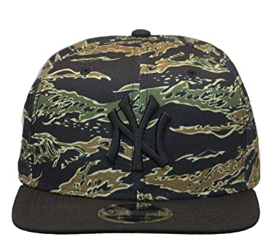 39585d5c4f1106 Amazon.com: MLB New York Yanees World Series 1996 Tiger Stripe Camo High  Crown Fifty Cap: Clothing