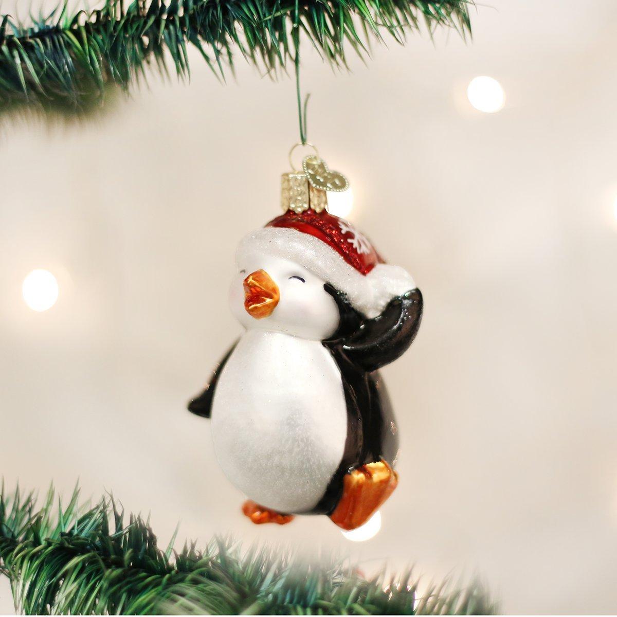 Amazon.com: Old World Christmas Dancing Penguin Glass Blown Ornament ...