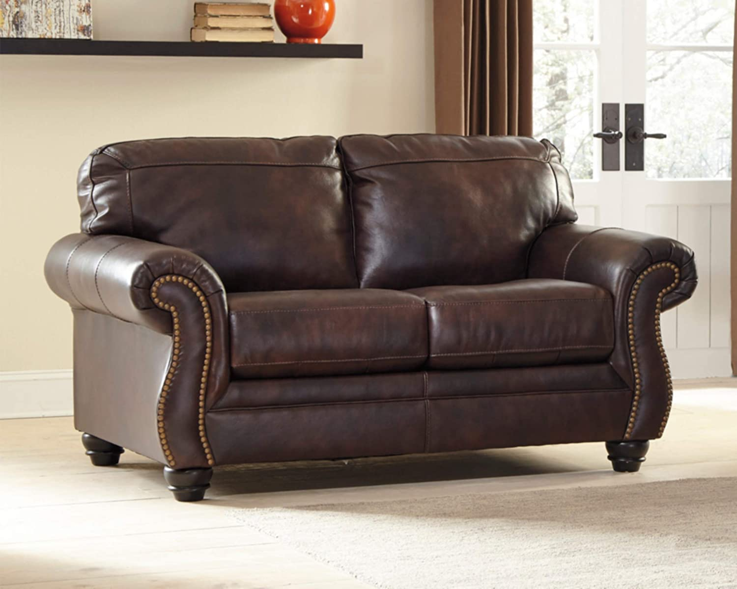 Ashley Furniture Signature Design – Bristan Traditional Style Faux Leather Loveseat with Nailhead Trim – Walnut Brown