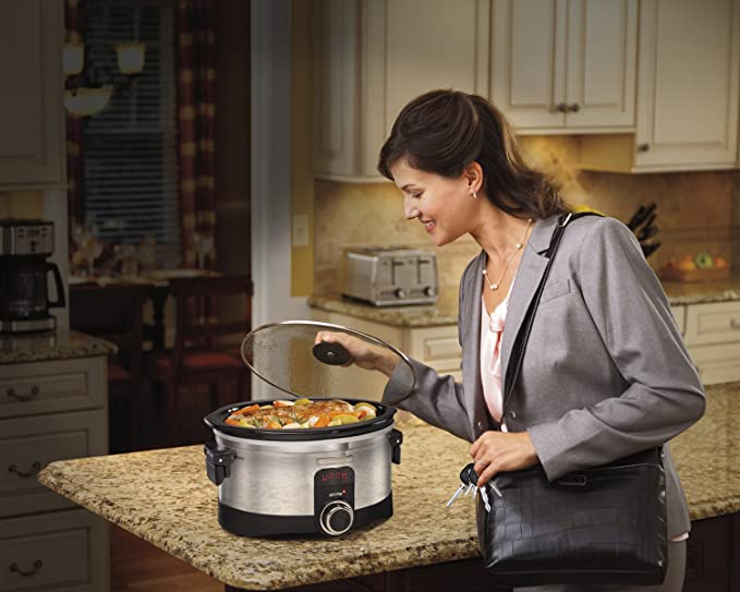 woman smelling the food cooked from the Hamilton Beach Slow Cookers