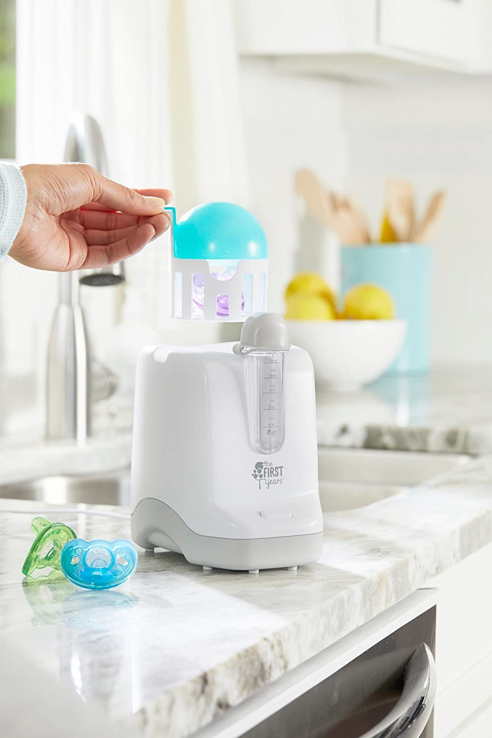 The First Years 2-in-1 Simple Serve Bottle Warmer | Quickly Warm Bottles of Breastmilk or Formula | Sanitize Pacifiers | Compact Design | Holds Wide Narrow and Angled Bottles