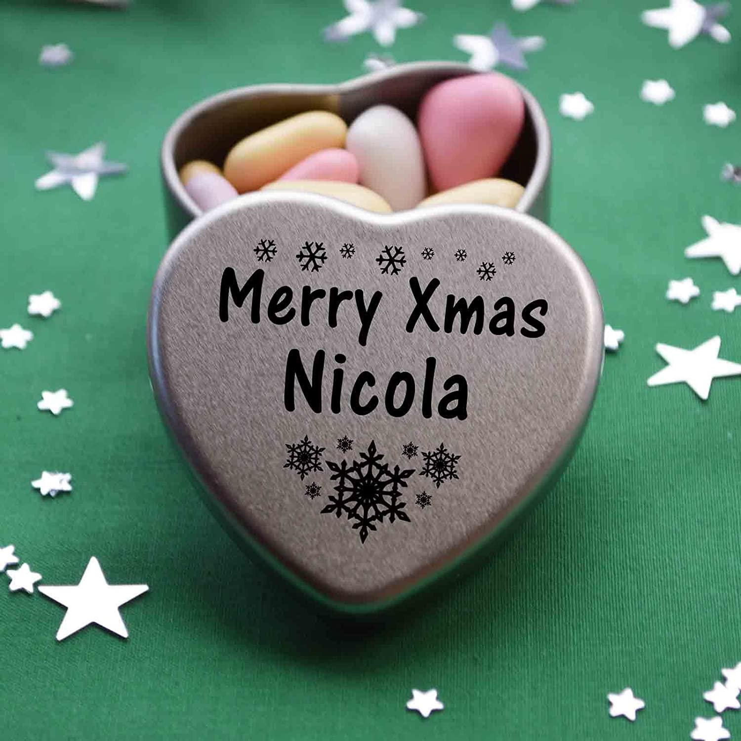 Three designs Available Great Christmas Present for Nicola Makes the perfect Stocking Filler or Card alternative Merry Xmas Nicola Mini Heart Gift Tin with Chocolates Fits Beautifully in the palm of your hand Tin Dimensions 45mmx45mmx20mm Father Christ