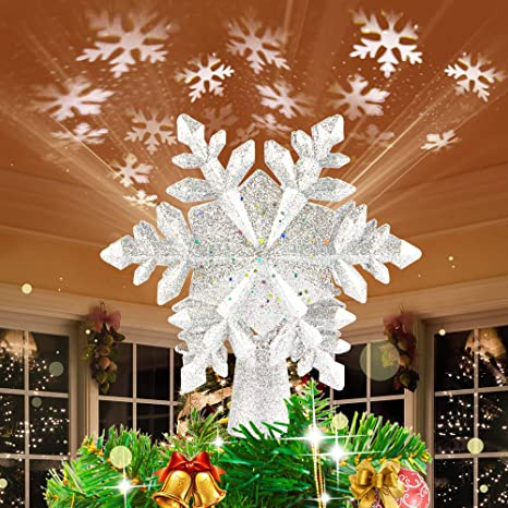 Amazon Com Hueliv Christmas Tree Topper Lighted Snowflake Topper With Led Rotating White Snowflake Projector Lights 3d Glitter Hollow Snowflake Tree Topper For Xmas Tree Decorations Gift For Kids Friends Kitchen Dining