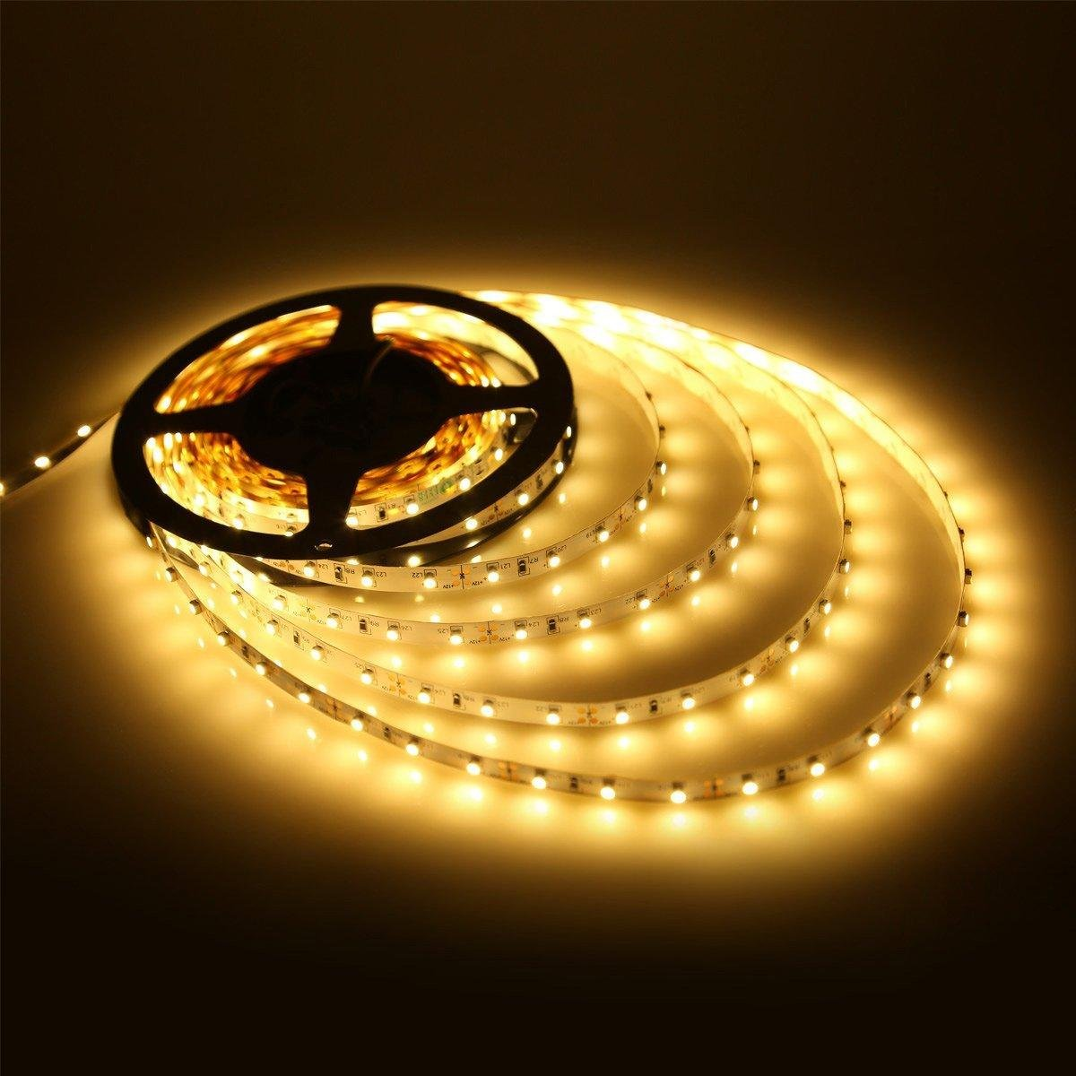 Buy waterproof smd 2835 led strip lights 5 meter dc 12v adapter buy waterproof smd 2835 led strip lights 5 meter dc 12v adapter led dimmer controller warm white online at low prices in india amazon mozeypictures Choice Image
