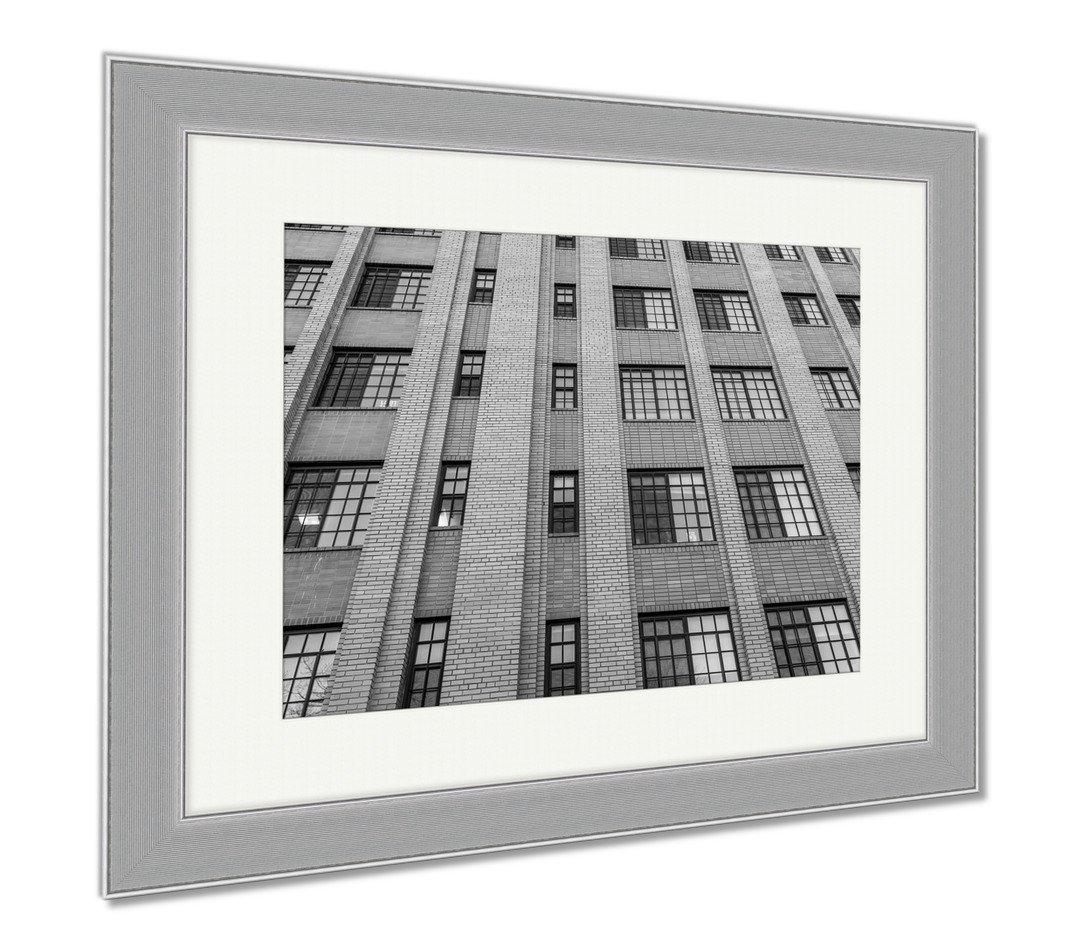 Ashley Framed Prints Many Blue Windows On Brick Highrise Building, Contemporary Decoration, Black/White, 26x30 (frame size), Silver Frame, AG6564322