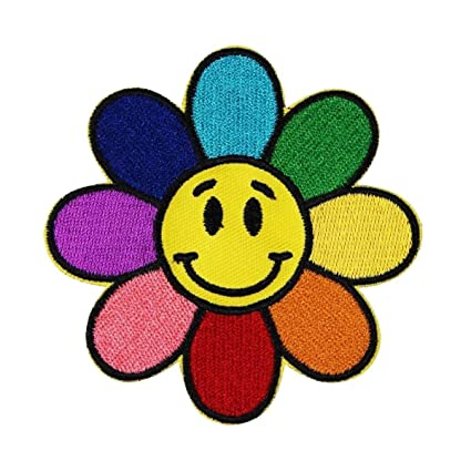 Smiley face rainbow. Flower patch hippie happy