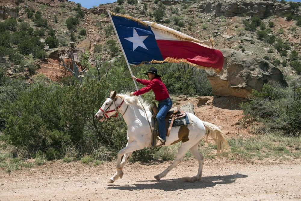 """2014 Photo A highlight of the """"Texas"""" outdoor musical drama, staged in the Pioneer Amphitheater carved from the rocks of Palo Duro Canyon southeast of Amarillo in the Texas Panhandle, are majestic rid"""
