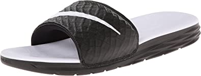 reinado no pueden ver Ruidoso  Amazon.com: Sandalia Nike Benassi Solarsoft para mujer: Shoes