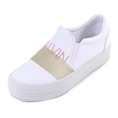 f3b21bedff62 Calvin Klein Women s Zelma Synthetic Slip On Platform Trainer White Gold   Amazon.co.uk  Shoes   Bags