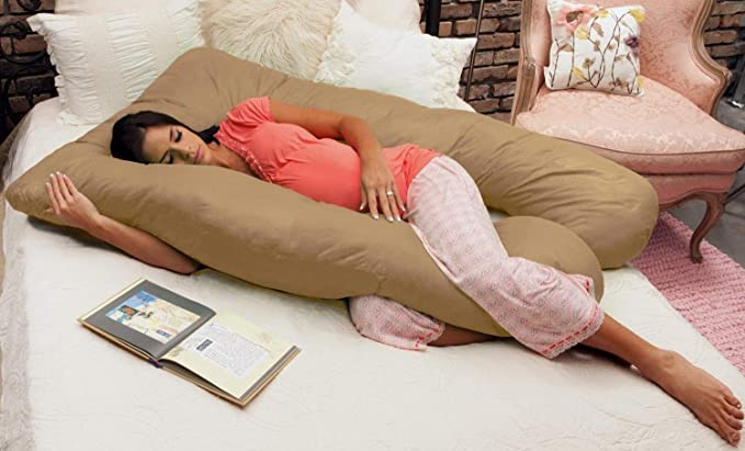 Picture of a pregnant woman laying on the Naomi Home Cozy Body Pillow